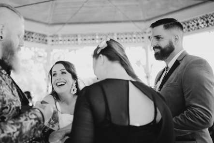 laughing bride at groomsman with groom and celebrant
